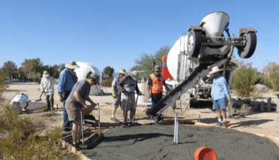 Laying the cement foundation for the new domes.
