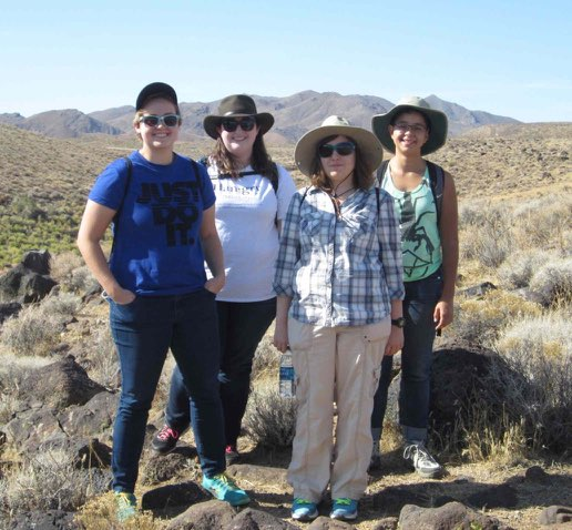 """Four Musketeers"" is a photo taken on a field trip at Sheep Springs in the El Pasos, where the temperature was about 105 deg. Left to right the folks are Daisy Zajicek, Emma Dauplaise, Kirsten Carroll, and Kara Jones; Daisy is finishing up at Cerro Coso, Emma and Kirsten are at UC Santa Cruz, and Kara is at CSU Bakersfield, all in anthropology."